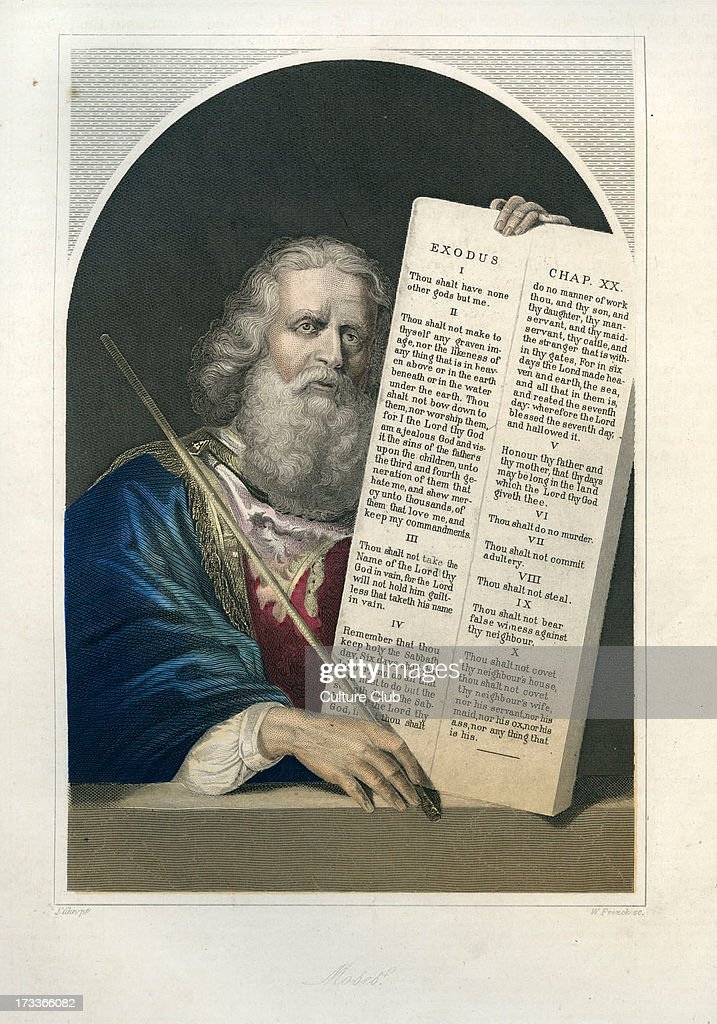 Moses holding the tablets inscribed with the Ten Commandments.