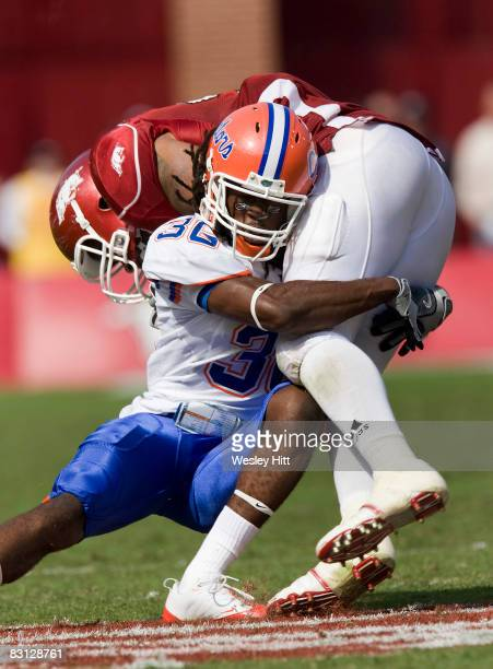 Moses Jenkins of the Florida Gators tackles DJ Williams of the Arkansas Razorbacks at Donald W Reynolds Stadium on October 4 2008 in Fayetteville...