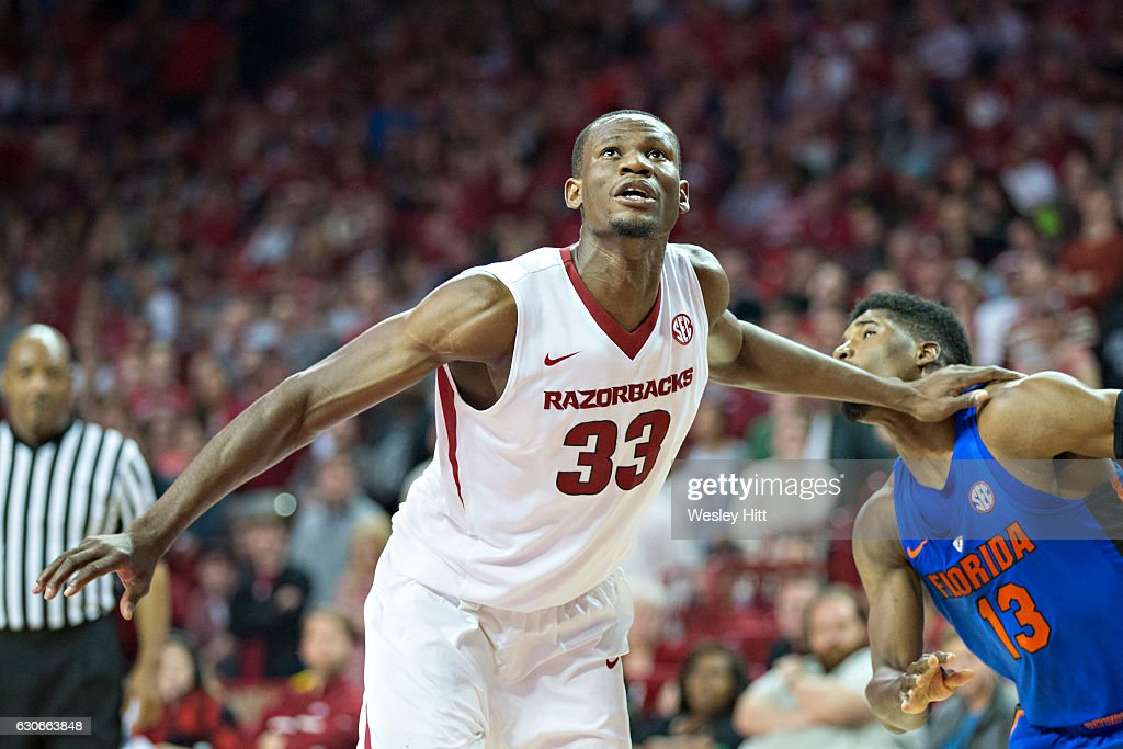 Moses Kingsley #33 of the Arkansas Razorbacks blocks out for a rebound against Kevarrius Hayes #13 of the Florida Gators at Bud Walton Arena on December 29, 2016 in Fayetteville, Arkansas. The Gators defeated the Razorbacks 81-72.