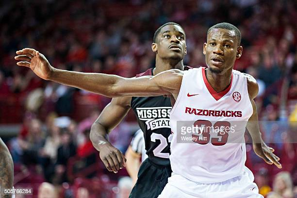 Moses Kingsley of the Arkansas Razorbacks blocks out Travis Daniels of the Mississippi State Bulldogs at Bud Walton Arena on January 9 2016 in...