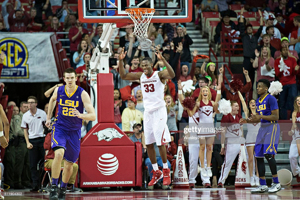 Moses Kingsley #33 of the Arkansas Razorbacks celebrates after dunking the basketball during a game against the LSU Tigers at Bud Walton Arena on February 23, 2016 in Fayetteville, Arkansas. The Razorbacks defeated the Tigers 85-65,