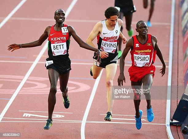Moses Kipsiro of Uganda crosses the line to win gold ahead of Silver medalist Josphat Kipkoech Bett of Kenya and Bronze medalist Cameron Levins in...