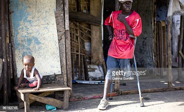 Moses Koli poses for a photo on June 16 2009 in Monrovia Liberia Moses Koli was one of Liberian warlord Charles Taylor's child soldiers and he lost a...