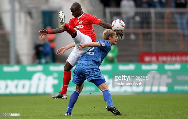 Moses Lamidi of Oberhausen and Bjoern Kopplin of Bochum battle for the ball during the Second Bundesliga match between RW Oberhausen and VfL Bochum...