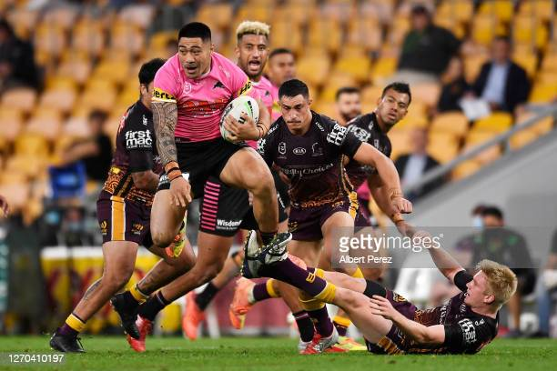 Moses Leota of the Panthers makes a break during the round 17 NRL match between the Brisbane Broncos and the Penrith Panthers at Suncorp Stadium on...