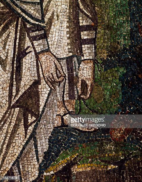 Moses loosening a sandal detail from Moses and the burning bush mosaic left of the lunette south wall of the presbytery Basilica of San Vitale...