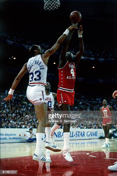 Moses Malone of the Eastern Conference AllStars shoots against Kareem AbdulJabbar of the Western Conference AllStars during the 1987 NBA All Star...