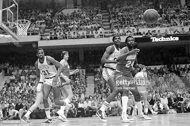 Moses Malone of the Houston Rockets catches an inbound pass while guarded by Robert Parish of the Boston Celtics at the Boston Garden circa 1982 NOTE...