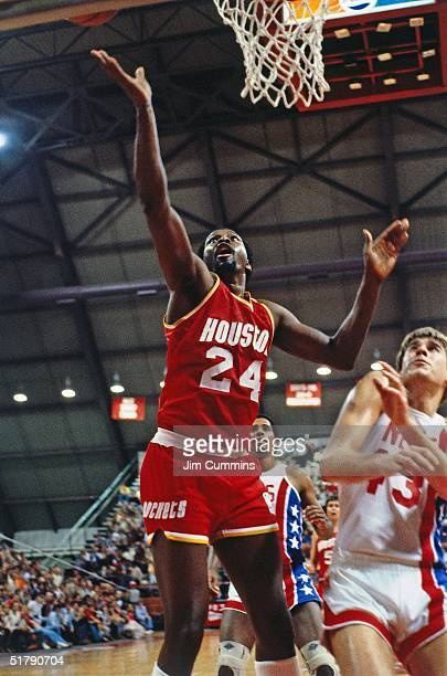Moses Malone of the Houston Rockets goes for a layup against the New Jersey Nets during the NBA game in New Jersey NOTE TO USER User expressly...