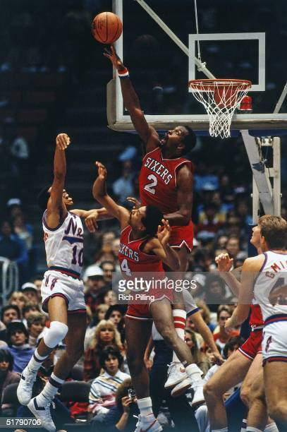 Moses Malone of the Philadelphia 76ers blocks a shot against the New Jersey Nets during a 1982 NBA game at the Brendan Byrne Arena in East Rutherford...