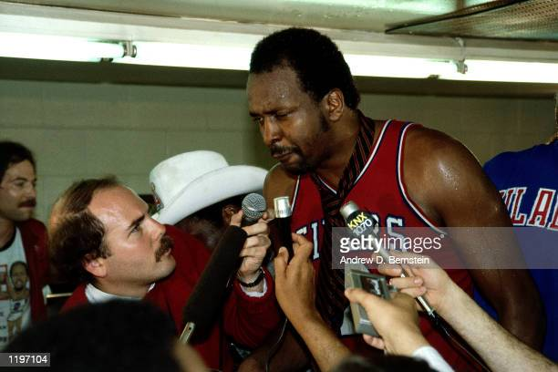 Moses Malone of the Philadelphia 76'ers gets interviewed by the media after winning the 1983 NBA Championship against the Los Angeles Lakers at the...