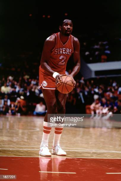 Moses Malone of the Philadelphia 76ers shoots a free throw against the Atlanta Hawks at The Omni during the 1983 NBA season in Atlanta, Georgia. NOTE...