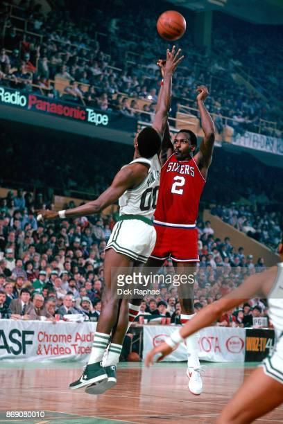 Moses Malone of the Philadelphia 76ers shoots against Robert Parish of the Boston Celtics circa 1986 at the Boston Garden in Boston Massachusetts...