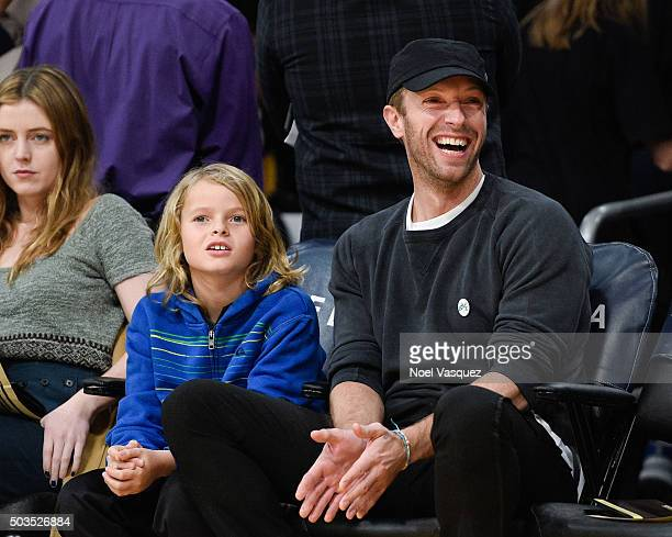 Moses Martin and Chris Martin attend a basketball game between the Golden State Warriors and the Los Angeles Lakers at Staples Center on January 5...