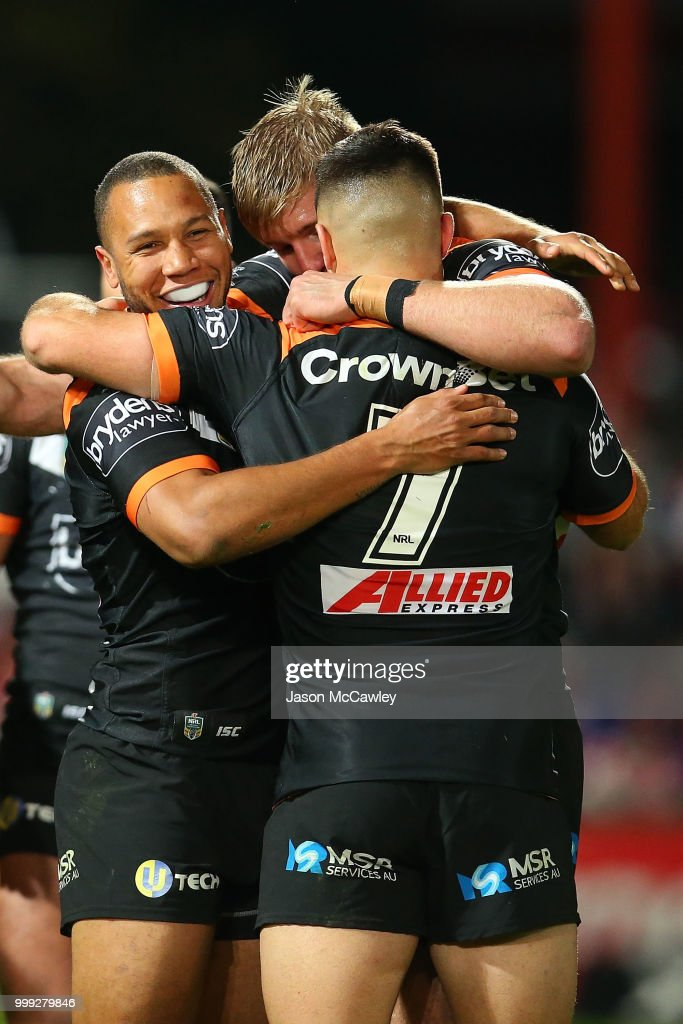 Moses Mbye celebrates with Luke Brooks of the Tigers after winning the round 18 NRL match between the St George Illawarra Dragons and the Wests Tigers at UOW Jubilee Oval on July 15, 2018 in Sydney, Australia.