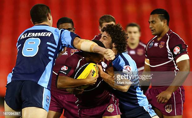 Moses Mbye of Queensland is tackled high during the U20s State of Origin match between New South Wales and Queensland at Centrebet Stadium on April...