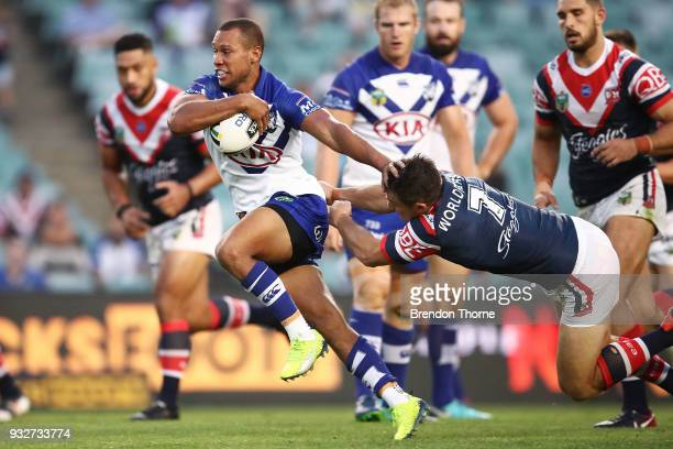 Moses Mbye of the Bulldogs breaks the Roosters defence during the round two NRL match between the Sydney Roosters and the Canterbury Bulldogs at...