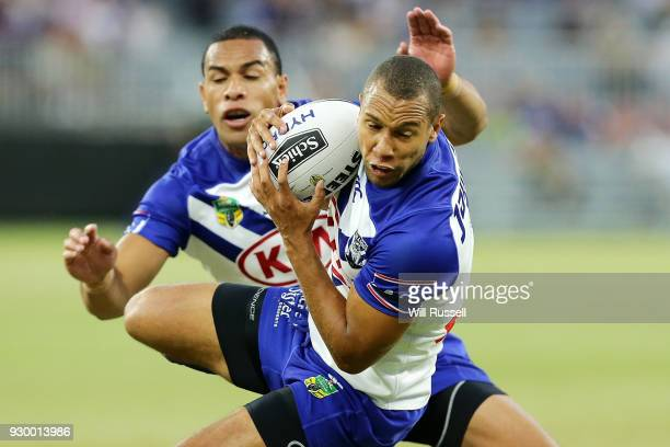 Moses Mbye of the Bulldogs catches the ball during the round one NRL match between the Canterbury Bulldogs and the Melbourne Storm at Perth Stadium...
