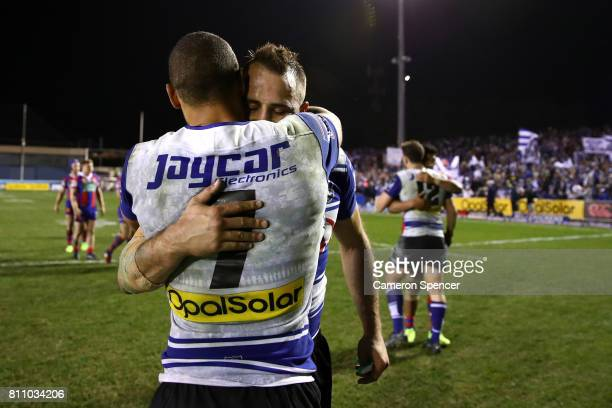 Moses Mbye of the Bulldogs embraces team mate Josh Reynolds after winning the round 18 NRL match between the Canterbury Bulldogs and the Newcastle...