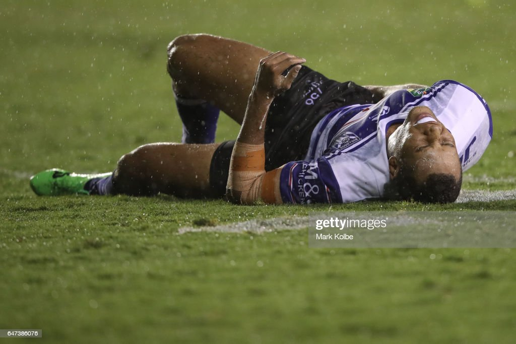Moses Mbye of the Bulldogs lies injured on the ground during the round one NRL match between the Canterbury Bulldogs and the Melbourne Storm at Belmore Sports Ground on March 3, 2017 in Sydney, Australia.