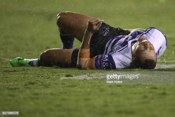 Moses Mbye of the Bulldogs lies injured on the ground during the round one NRL match between the Canterbury Bulldogs and the Melbourne Storm at...