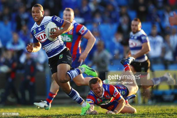 Moses Mbye of the Bulldogs makes a break during the round 18 NRL match between the Canterbury Bulldogs and the Newcastle Knights at Belmore Sports...