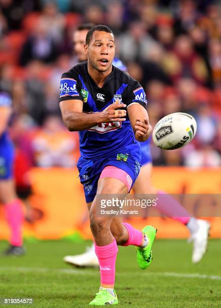 Moses Mbye of the Bulldogs passes the ball during the round 20 NRL match between the Brisbane Broncos and the Canterbury Bulldogs at Suncorp Stadium...
