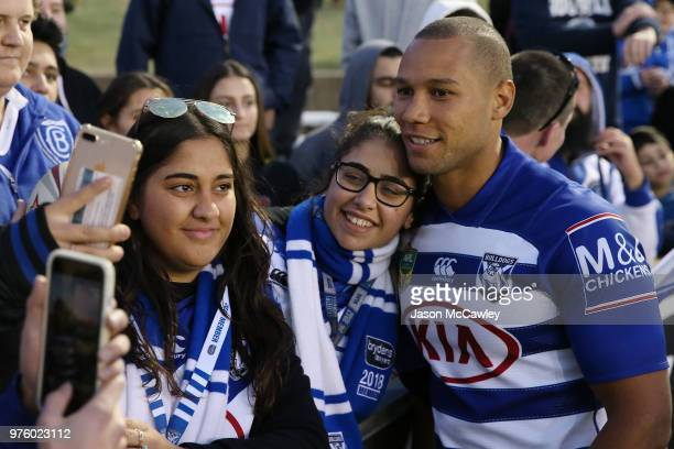 Moses Mbye of the Bulldogs poses with fans after the round 15 NRL match between the Canterbury Bulldogs and the Gold Coast Titans at Belmore Sports...