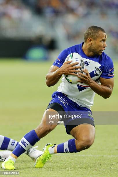 Moses Mbye of the Bulldogs runs the ball during the round one NRL match between the Canterbury Bulldogs and the Melbourne Storm at Optus Stadium on...
