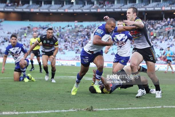 Moses Mbye of the Bulldogs scores a try during the round three NRL match between the Bulldogs and the Panthers at ANZ Stadium on March 23 2018 in...