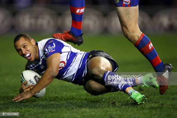Moses Mbye of the Bulldogs scores the winning try during the round 18 NRL match between the Canterbury Bulldogs and the Newcastle Knights at Belmore...
