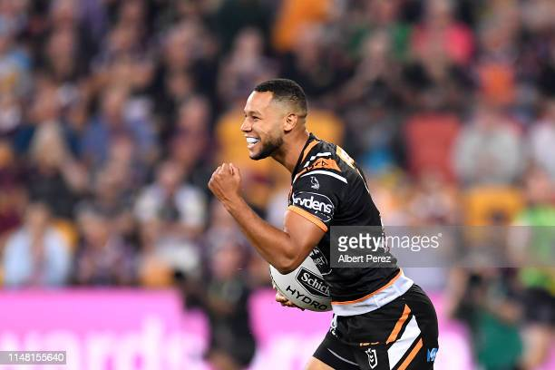 Moses Mbye of the Tigers celebrates scoring his team's first try during the round nine NRL match between the Wests Tigers and the Penrith Panthers at...