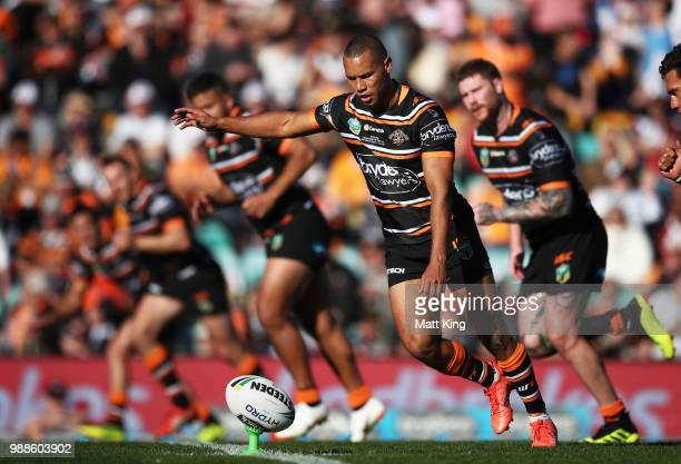 Moses Mbye of the Tigers kicks off during the round 16 NRL match between the Wests Tigers and the Gold Coast Titans at Leichhardt Oval on July 1 2018...