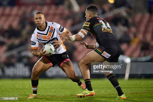 Moses Mbye of the Tigers runs the ball during the round 16 NRL match between the Panthers and the Wests Tigers at Panthers Stadium on August 29, 2020...
