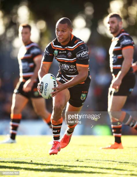 Moses Mbye of the Tigers runs with the ball during the round 16 NRL match between the Wests Tigers and the Gold Coast Titans at Leichhardt Oval on...
