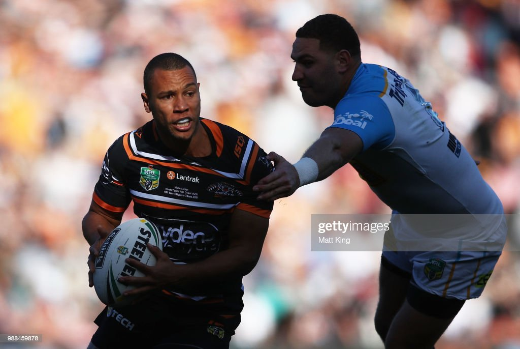 Moses Mbye of the Tigers takes on the defence during the round 16 NRL match between the Wests Tigers and the Gold Coast Titans at Leichhardt Oval on July 1, 2018 in Sydney, Australia.