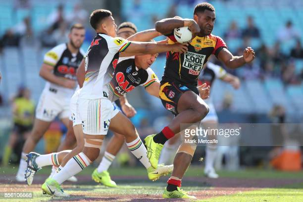 Moses Meninga of the Hunters is tackled during the 2017 State Championship Final between the Penrith Panthers and Papua New Guinea Hunters at ANZ...