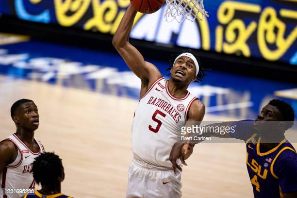 Moses Moody of the Arkansas Razorbacks goes to the basket as he is fouled by Darius Days of the LSU Tigers during the first half of their semifinal...
