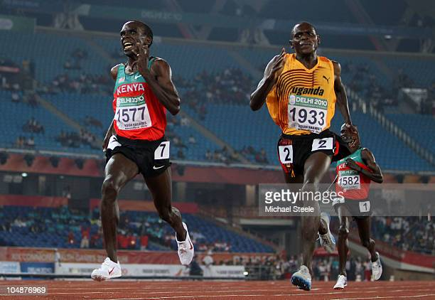 Moses Ndelema Kipsiro of Uganda races to line to win gold ahead of Ellud Kipchoge of Kenya during day three of the Delhi 2010 Commonwealth Games at...