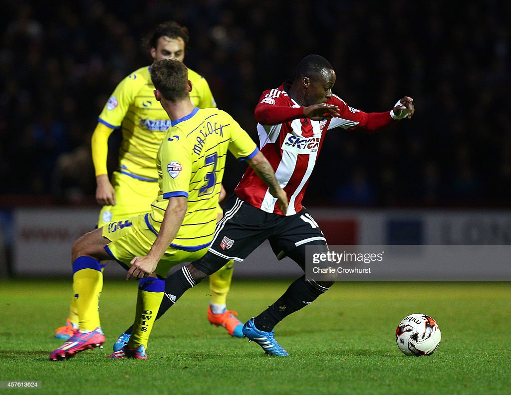 Moses Odubajo attacks for Brentford during the Sky Bet Championship match between Brentford and Sheffield Wednesday at Griffin Park on October 21, 2014 in Brentford, England.