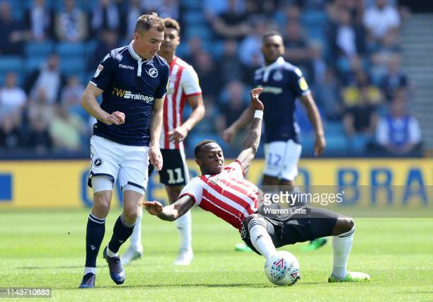 Moses Odubajo of Brentford and Jed Wallace of Millwall in action during the Sky Bet Championship match between Millwall and Brentford at The Den on...
