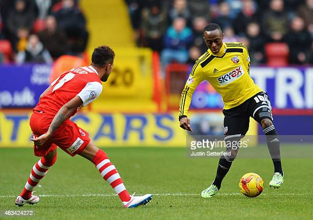 Moses Odubajo of Brentford is challenged by Frederic Bulot of Charlton Athletic during the Sky Bet Championship match between Charlton Athletic and...