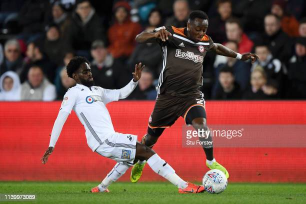 Moses Odubajo of Brentford is challenged by Nathan Dyer of Swansea City during the Sky Bet Championship between Swansea City and Brentford at Liberty...