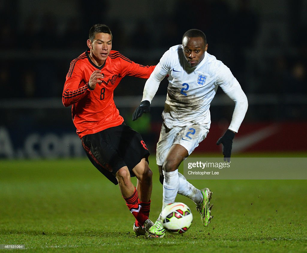 Moses Odubajo of England gets away from Irving Rodrigo Lozano Bahena of Mexico during the U20 International Friendly match between England and Mexico at The Hive on March 25, 2015 in Barnet, England.