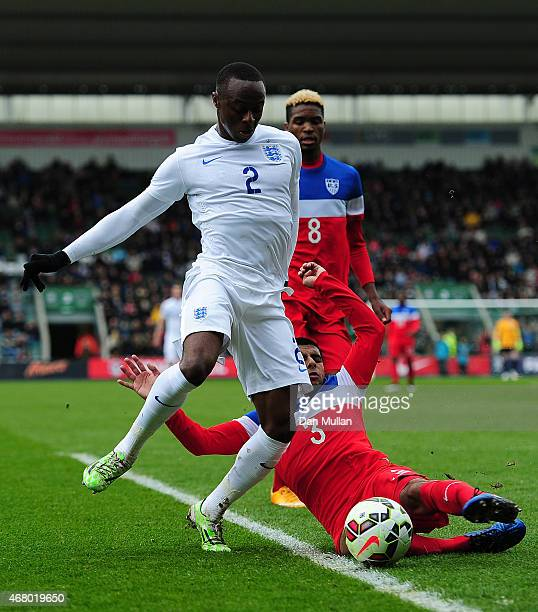 Moses Odubajo of England is tackled by John Requejo of USA during the International Friendly match between England U20 and USA U20 at Home Park on...