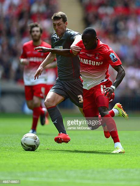 Moses Odubajo of Leyton Orient battles with Richard Smallwood of Rotherham United during the Sky Bet League One Playoff Final between Leyton Orient...