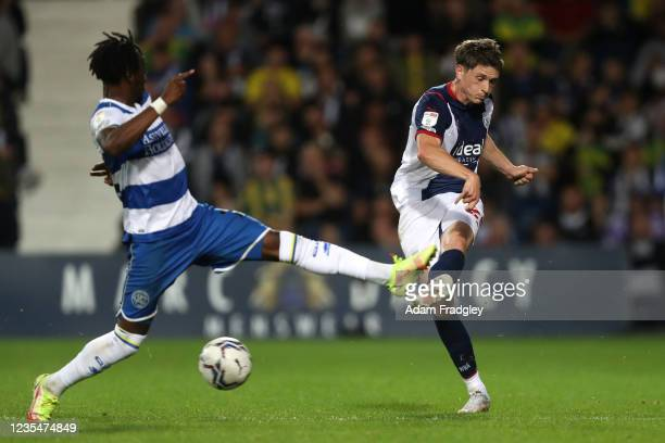 Moses Odubajo of Queens Park Rangers and Adam Reach of West Bromwich Albion during the Sky Bet Championship match between West Bromwich Albion and...