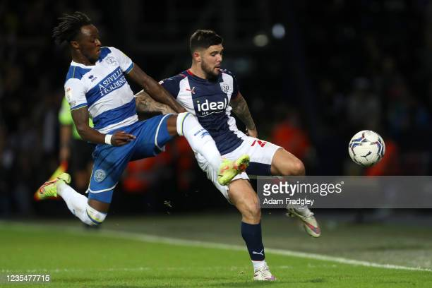 Moses Odubajo of Queens Park Rangers and Alex Mowatt of West Bromwich Albion during the Sky Bet Championship match between West Bromwich Albion and...