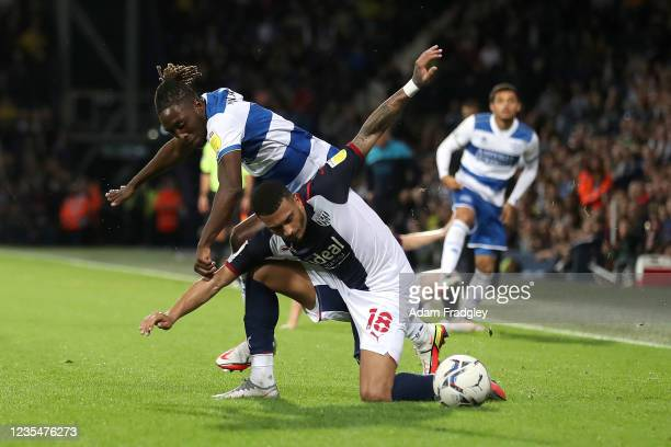 Moses Odubajo of Queens Park Rangers and Karlan Grant of West Bromwich Albion during the Sky Bet Championship match between West Bromwich Albion and...