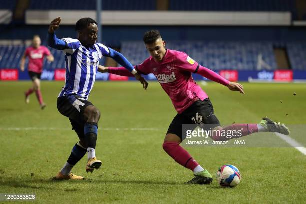 Moses Odubajo of Sheffield Wednesday and Lee Buchanan of Derby County during the Sky Bet Championship match between Sheffield Wednesday and Derby...